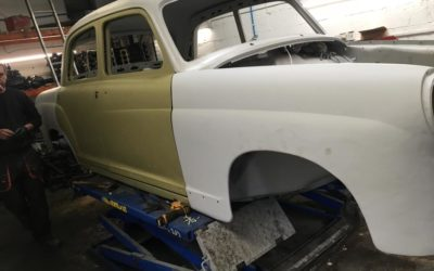Old car restoration. Body workshop and car body painting, wheels renewing.